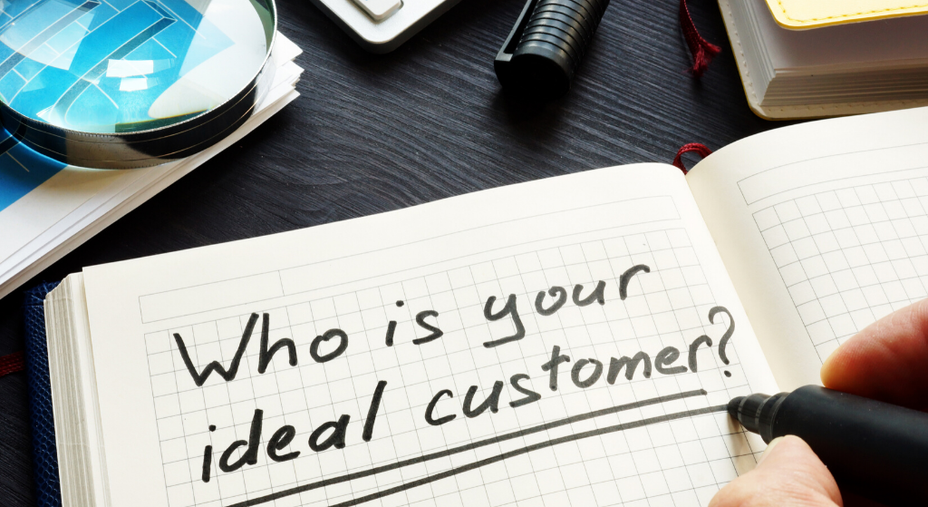 Open book with someone writing who is your ideal customer