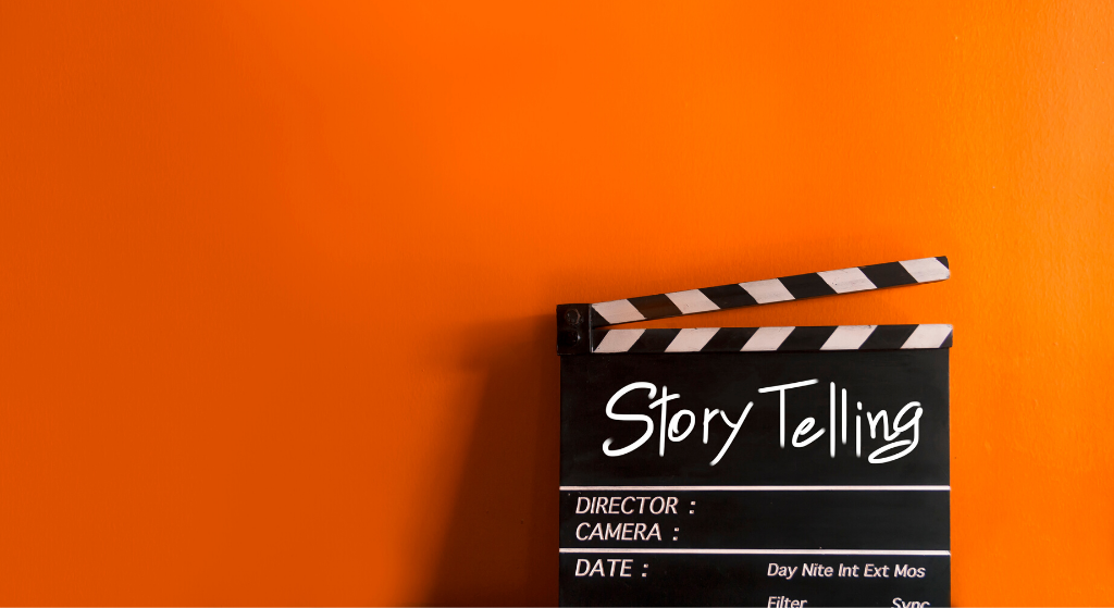clapper board on orange background